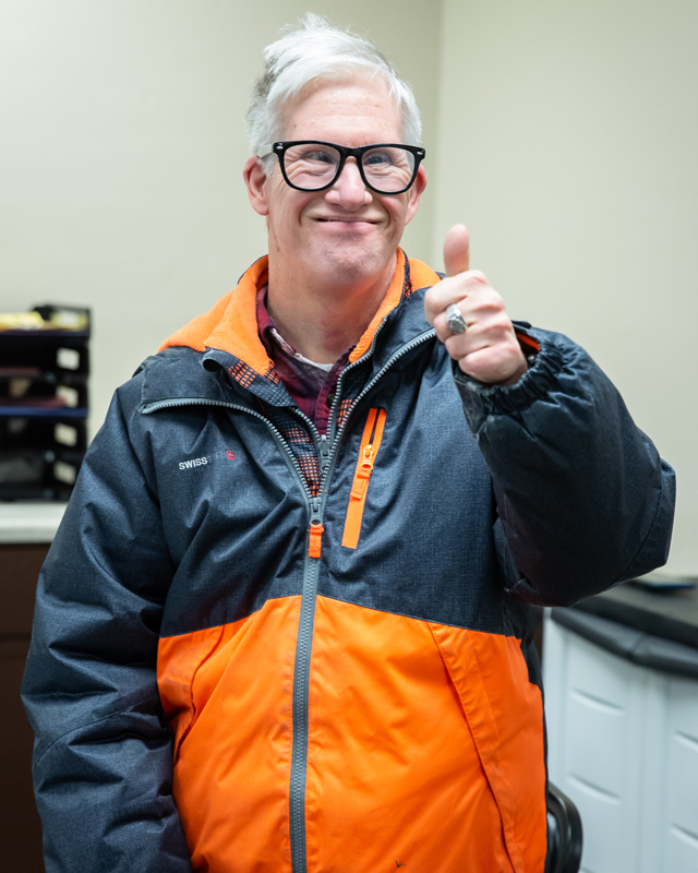 A male Ability member giving the thumbs up