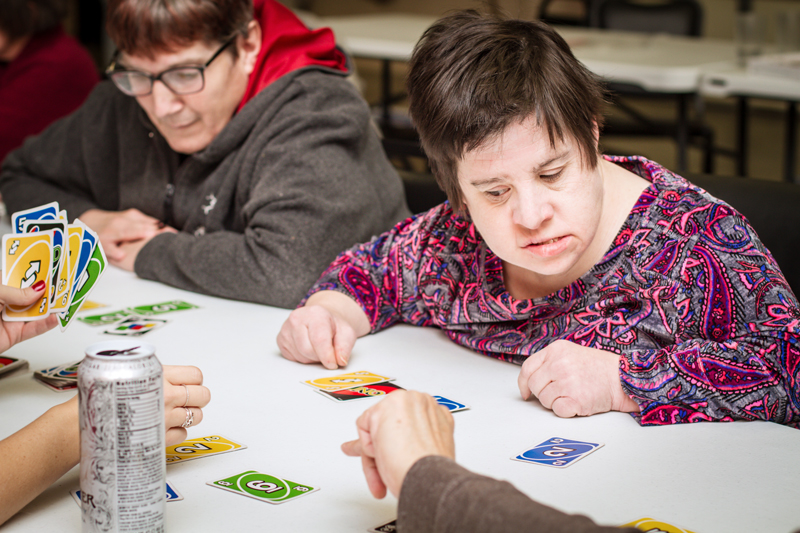 Ability members playing a card game