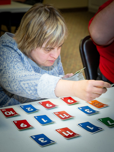 Ability member playing a card game