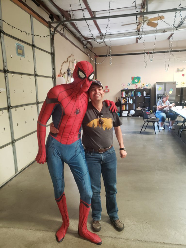 Ability member posing with spider man