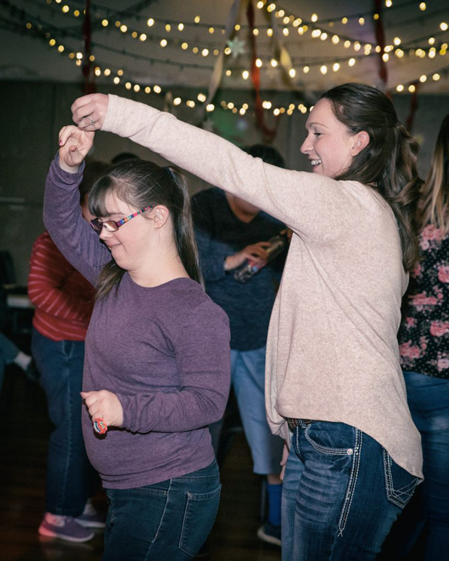 Ability members dancing at an event