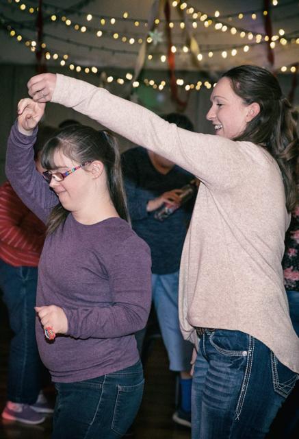 Ability member and staff member dancing