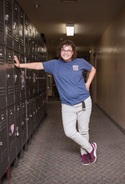 Ability staff member leaning against lockers