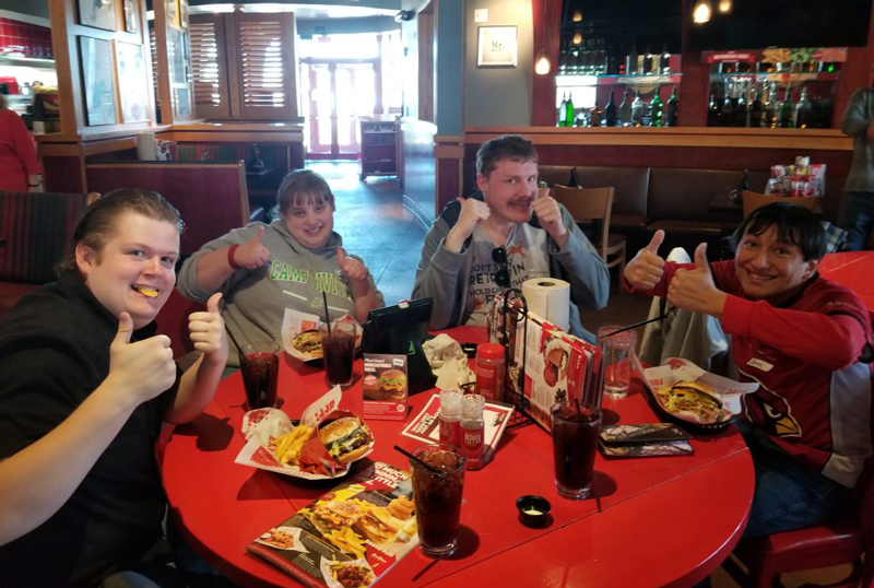 Group of ability members at a burger restraunt
